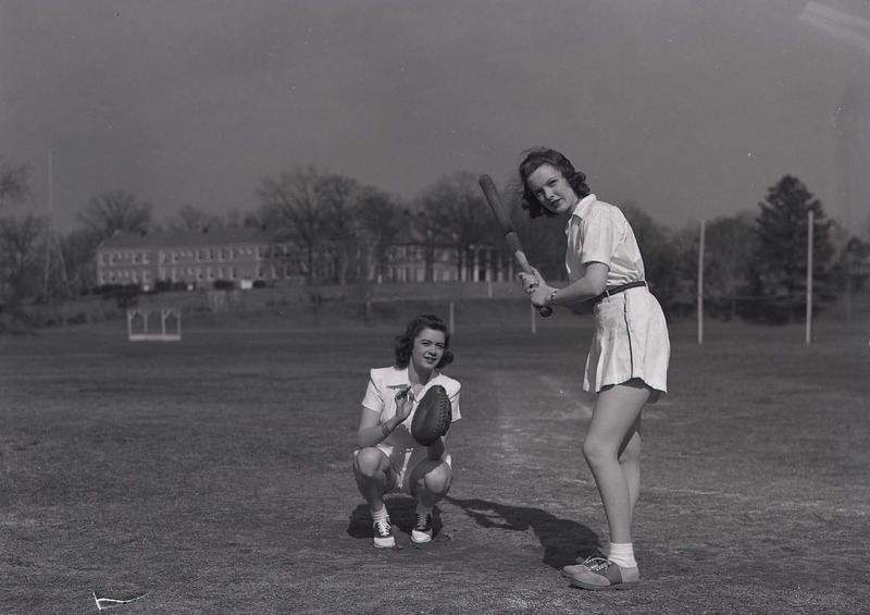 Two women play baseball on the Woman's College campus at Duke University (now East Campus) in 1941.