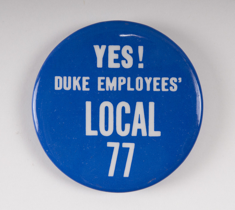 Pin worn at the 1968 Silent Vigil on Chapel Quad.  The vigil was held for several days in memory of Dr. Martin Luther King, Jr., and in support of better wages for Duke food service workers.
