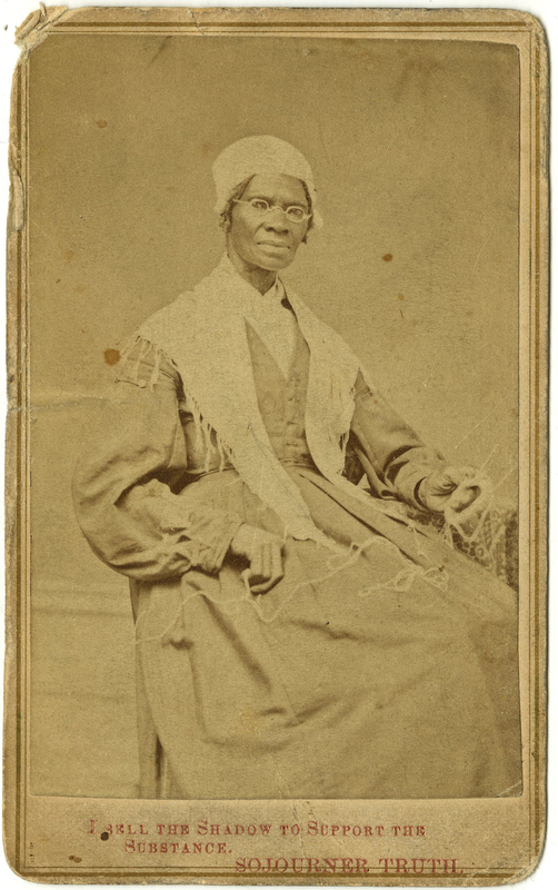"Worn and yellowed photograph of a Black woman seated holding knitting, wearing glasses and a white shawl with the text ""I sell the shadow to support the substance"" underneath"