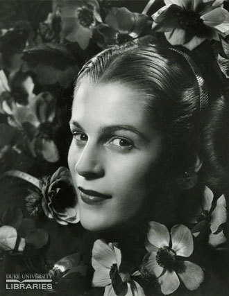 Black and white portrait of a white lady face surrounded by flowers
