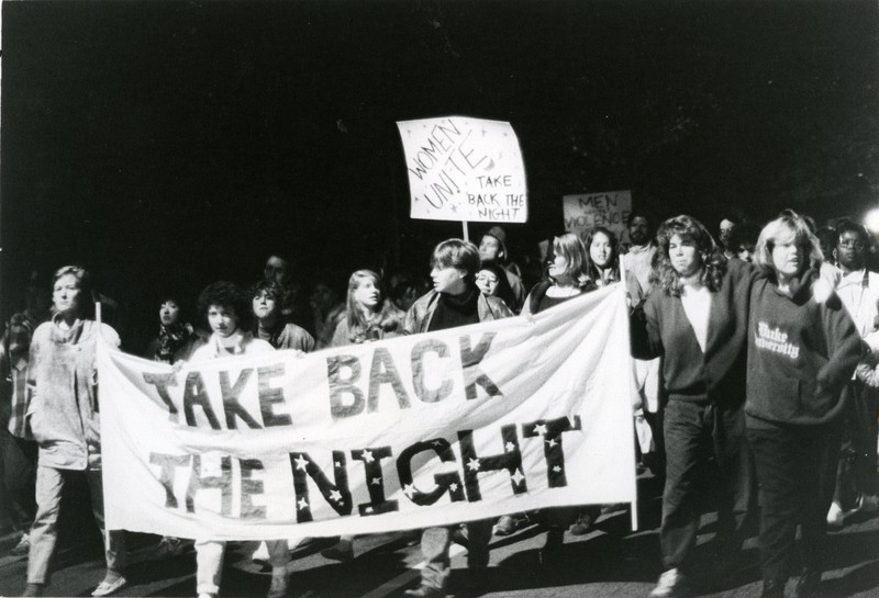 Marchers partake in a Take Back the Night demonstration on campus in the mid- to late-1980s.