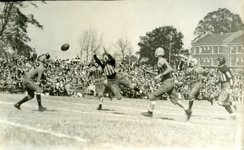 A football game at Trinity College in the 1920s.  The game is being played on what is now East Campus, but was at the time the main Trinity College campus.  The game occurred before the construction of Wallace Wade Stadium, and likely before Duke University was created in 1924.