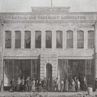 "First Home Office Building as it appeared on January 1, 1906. The building was located on West Parrish Street-- ""Black Wall Street""--and was later demolished in 1920."