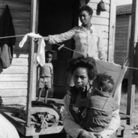 &quot;Back porch, two women and two children Battle&#039;s Quarters, Decatur County, GA, 1971<br />