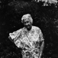 Santa Rodriguez Carvahlo, first generation Hawaiian-Puerto Rican, in front of her lava oven, Kukuihaele Plantation, Big Island, HI 1981