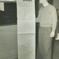 Devils Captain Bob Barnett with congratulatory scroll from UNC-Chapel Hill