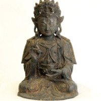 &quot;Guanyin Buddha with Lotus &amp; Bowl<br /> Bronze, Ming Dynasty<br /> The James A. Thomas Collection<br /> Gift of Mrs. James A. Thomas<br /> <br /> Guanyin is the Buddhist manifestation of Great Compassion, with origins in Hindu&#039;s Bodhisattva Avalokiteshvara. The elaborate crown, regal robes, long hair and ear pendants are characteristic of kingly ornament. This figure has Tibetan features of dress and style. In his right hand appears a lotus bud, symbol of purity. His right hand cradles a bowl, symbol of mercy. Most of the gold gilt paint that decorated this figure is now faded.&quot;