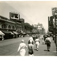 Boardwalk, northeast corner of Pennsylvania Ave. facing west. [Women in bathing attire, Chesterfield billboard], July 11, 1936.<br />