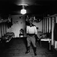 Walton, a migrant laborer and union organizer in a workers' barracks, Glassboro, NJ 1981