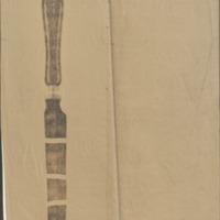 A knife blade broken into four pieces