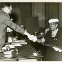 Mrs. Bessie Whitted receives service award, 1940s