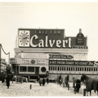 Boardwalk. [Horses on beach and Calvert sign], December 18, 1938.<br />