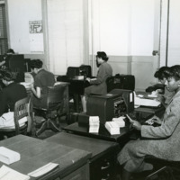 Clerks handle policy information, 1940s