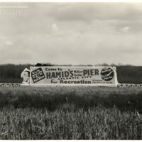 Railroad. [Hamid&#039;s Million Dollar Pier billboard], May 1, 1939.<br />