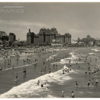[View of beach; Camel billboard in background], July 3, 1938.<br />