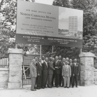 A group of executives stand in front of a sign that announces &quot;New home office for North Carolina Mutual Life Insurance Company.&quot;<br /><br />