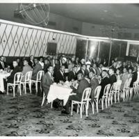 Newark District employees enjoy a banquet dinner, 1960s