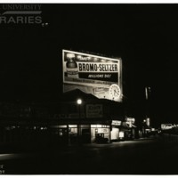Boardwalk. [Bromo Seltzer billboard, night], February 22, 1939.<br />