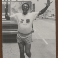 Charles Blackmon, Vice President, insurance operations, had the honor of helping carry the Olympic Torch through the streets of Durham prior to the opening of the U.S. Olympic Festival in July 1987. <br /> <br /> Photograph appeared on the cover of The Whetstone 3rd/4th Quarter 1987-the Year in Review.