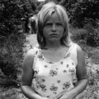 Migrant girl in orange grove, outside Tampa, FL, 1979<br /> <br /> John Moses Photographs<br /> gelatin silver print