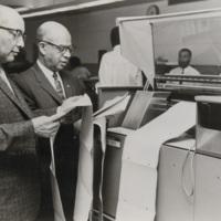 Joseph W. Goodloe and Asa T. Spaulding examine printout