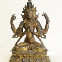&quot;Avalokiteshvara<br /> Nepalese 17th century<br /> The James A. Thomas Collection<br /> Gift of Mrs. James A. Thomas<br /> <br /> Avalokiteshvara is a merciful and compassionate Hindu deity. Here he is seated on a double lotus throne, regally arrayed and draped with jewelry, in the padmasana pose of prayer and contemplation. Note the five-point diadem with the Amitabha Buddha entwined in his hair.&quot;