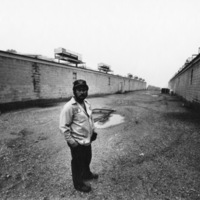 A mushroom farm crew chief in front of mushroom barns, Kennett Square, PA 1981