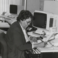 Unidentified employee working at desk