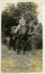 Doris riding at Duke Farms, 1915-1920