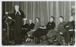 Doris Duke listens to Wilbur C. Davison at a Founders' Day ceremony, 1956