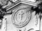 Trinity College seal.
